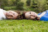 foto of love couple  - Cute young couple laying in the grass - JPG