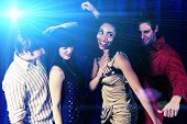 picture of night-club  - Attractive friends dancing at a night club - JPG