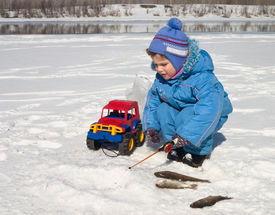 picture of ice fishing  - The boy the child on winter fishing - JPG