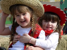 pic of hayride  - Little Cowgirls yeehawing at a preschool rodeo - JPG