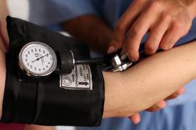 foto of medical assistant  - Medical worker checking blood pressure - JPG