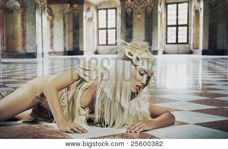 Fine art photo of a cute woman in elegance interior
