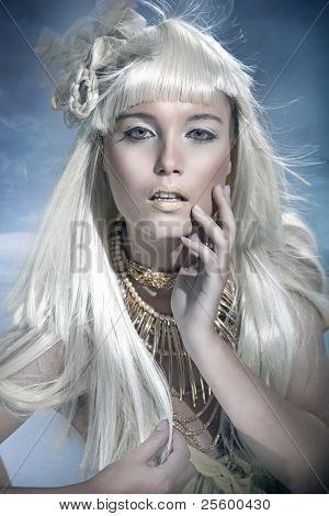Attractive blond beauty in winter scenery