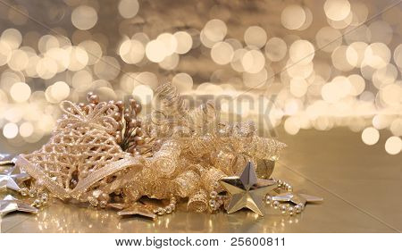 Christmas background of golden decorations on a background of defocussed lights