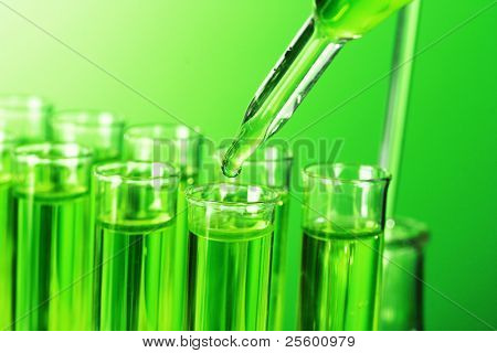 Test-tubes on green background