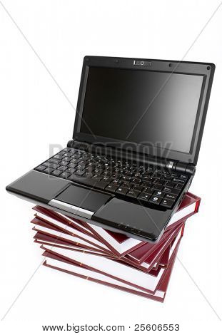 laptop on a pile of books