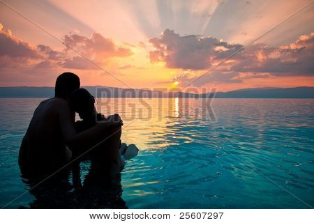 Romantic couple looking at sunset