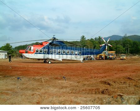 emergency helicopter transporting forensic doctors to khao lak, thailand