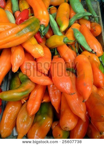 orange chilis in market, lima, peru
