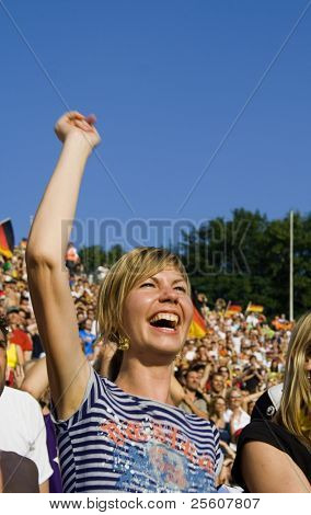 happy lady supporting her team