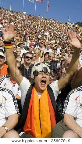 football fan with his hands in the air