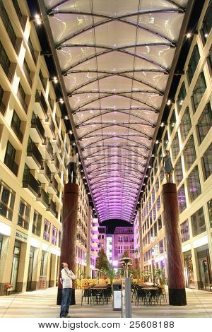 shopping mall and cafe at night in Berlin, Germany