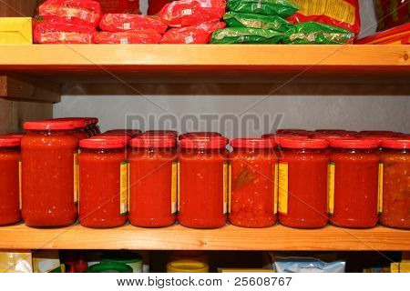 jars of tomato sauce on the shelf in an organic shop