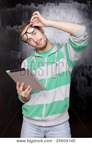 Good Looking Smart Nerd Man With Tablet Computer