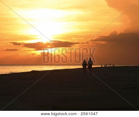 Couple Sunset Walk On Sanibel Beach