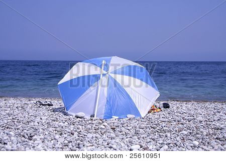 man sitting on pebble beach