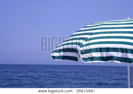 green and white striped parasol at seaside