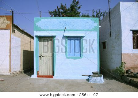 blue indian house in village in hampi, india