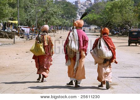 three wandering sadhus in hampi