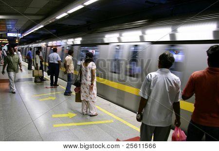 passengers awaiting metro train, delhi, india