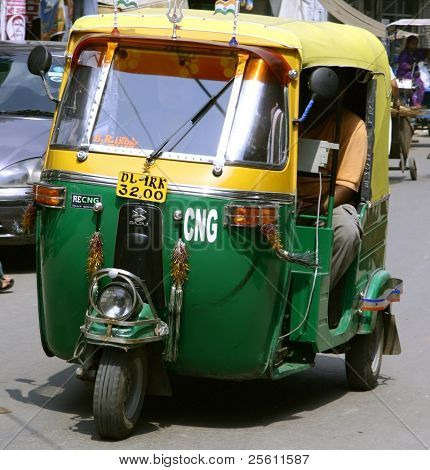 auto rickshaw driving on road, delhi, india