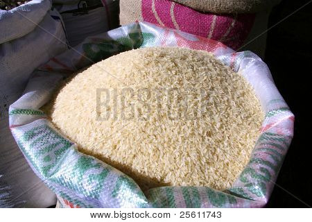 white rice in sack at market