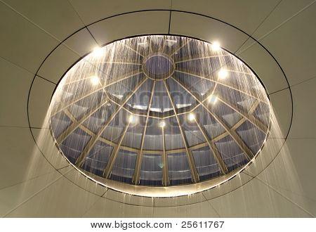 circular waterfall ceiling at madrid airport, spain