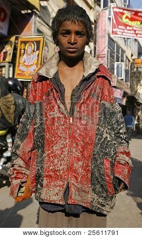 young beggar boy in paharganj delhi, india