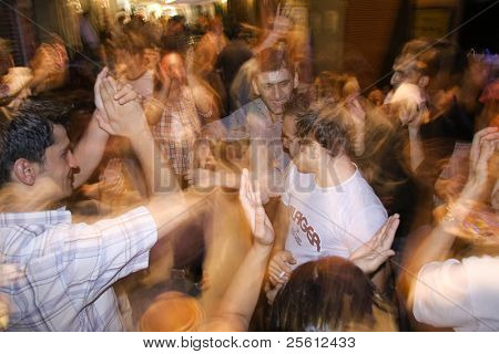 ISTANBUL, TURKEY - JULY 25 : Turkish youth enjoying dancing in the streets of Taksim in Istanbul, Turkey on July 25, 2007. Taksim is a popular destination for tourists and locals of Istanbul.