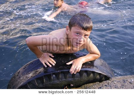 ISTANBUL, TURKEY - JULY 25 : Turkish boys enjoy swimming in Istanbul harbour on July 25, 2007 in Istanbul, Turkey. Literacy rate here is 93.39% (over 6 years of age), it's on top in country's average.