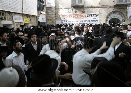 MERON, ISRAEL - MAY 6: Lag Ba'omer pilgrims dance during the festivities May 6, 2007 in Meron. Lag Ba'omer is a Jewish holiday where thousands of Jews make pilgrimage to Meron, Israel.