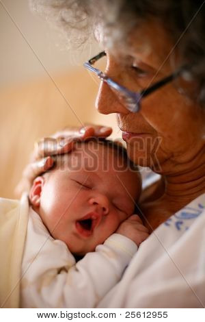 Sleeping baby in grand mothers arms