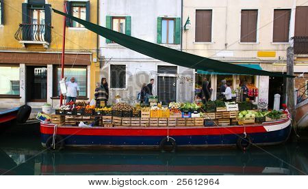 VENICE - OCT 28. Fruit and vegetable stall on boat on canal on October 28, 2009 in Venice, Italy. The population of Venice decreases yearly making local business increasingly difficult.