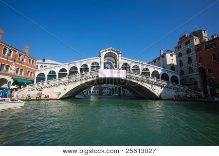 VENICE - OCTOBER 26: Crowds on the Rialto Bridge on October 26, 2009 in Venice, Italy. Originally built out of wood and having collapsed, in 1591 was completed out of stone.
