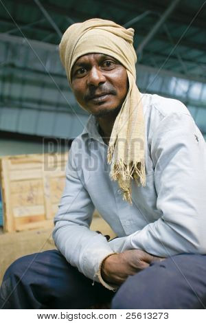 DELHI - FEBRUARY 19: Portrait of male worker with headscarf at train station on February 19, 2008 in Delhi, India. These men are not paid more than 2,5 dollars a day.
