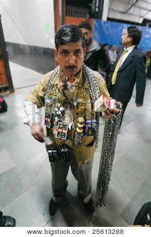 DELHI - FEBRUARY 19: Vendor in train station selling chains and locks to secure luggage during trip on February 19, 2008 in Delhi, India. Thieves are always on the look out on trains.