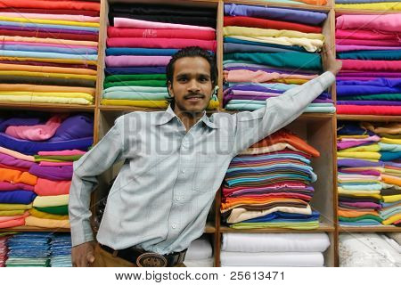 DELHI - JAN 19: Young indian promoting his textile fabrics on January 19, 2008 in Delhi, India. Textiles exports may touch $24 billion in 2010-11.