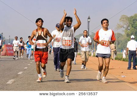 DELHI - OCTOBER 28: Group of young Indians running the Half Marathon on October 28, 2007 in Delhi, India. The 2009 event attracted around 29,000 runners of all ages.