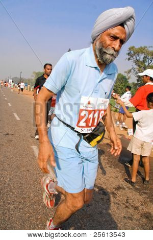 DELHI - OCTOBER 28: Sikh man running Delhi Half marathon on October 28, 2007 in Delhi, India. The 2009 event attracted around 29,000 runners of all ages.