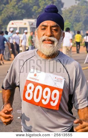 DELHI - OCTOBER 28: Elderly bearded Sikh man with turban competing in marathon on October 28, 2007 in Delhi, India. The 2009 event attracted around 29,000 runners from all walks of life.