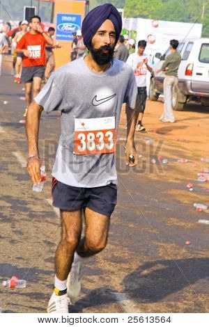 DELHI - OCTOBER 28: Young bearded Sikh man with turban competing in marathon on October 28, 2007 in Delhi, India. The 2009 event attracted around 29,000 runners from all walks of life.