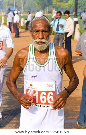 DELHI - OCTOBER 28: Elderly bearded Sikh man competing in marathon on October 28th, 2007 in Delhi, India. The 2009 event attracted around 29,000 runners.