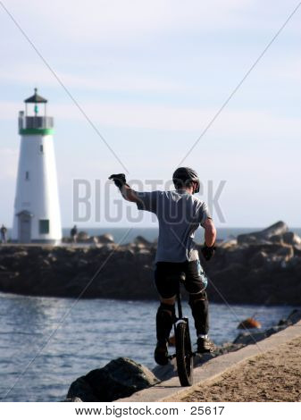 Boy On The Unicycle At Santa Cruz, CA