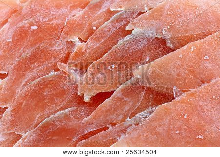 Closeup photo of frozen sliced raw salmon