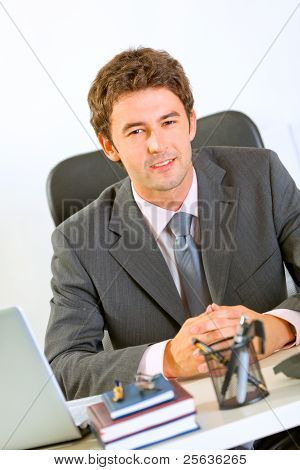 Portrait Of Happy Modern Businessman In Office