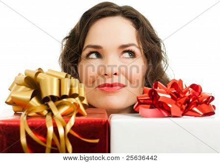 Beautiful Woman Peeking Over Presents