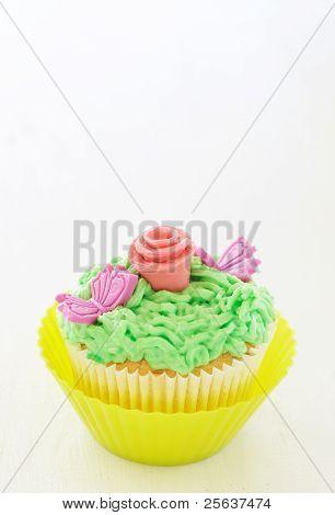 Vanilla Cupcake With Rose Decorations
