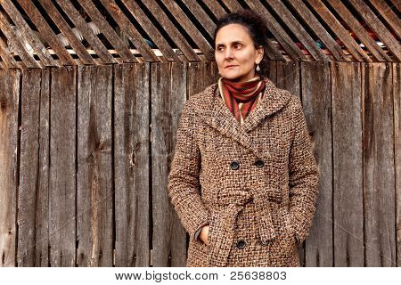 Woman Near Wooden Wall Outdoor