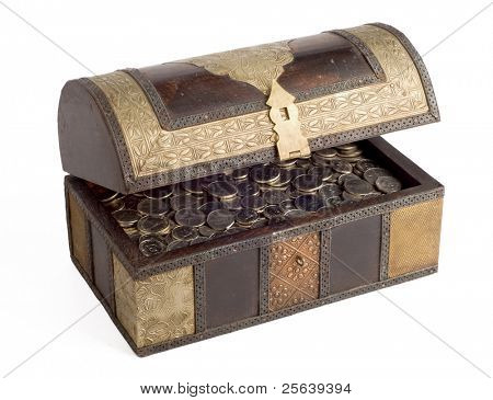 An open, antique trunk filled with UAE Dirhams