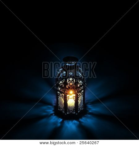 An illuminated Arabic lantern on back background